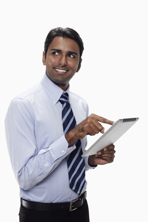 Businessman using digital tablet Stock Photo - 17954567