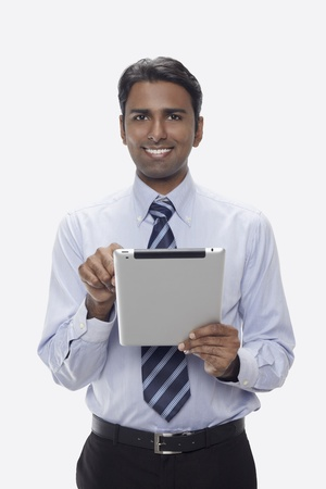 Businessman using digital tablet Stock Photo - 17954564