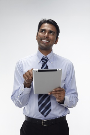 Businessman using digital tablet Stock Photo - 17954575
