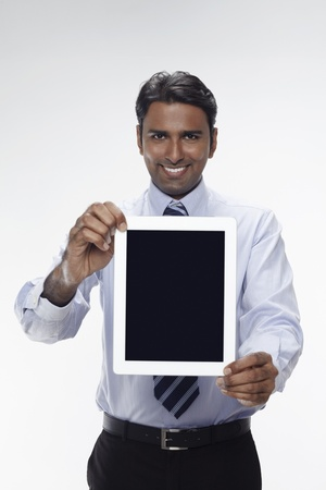 Businessman showing digital tablet Stock Photo - 17954568