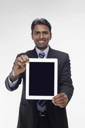 Businessman showing digital tablet photo