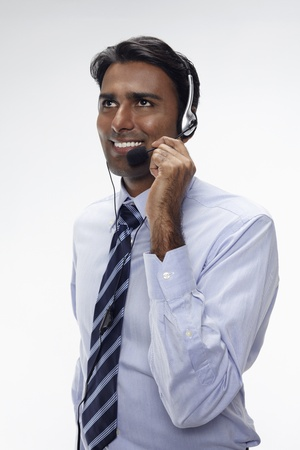 Businessman wearing headset Stock Photo - 17954577