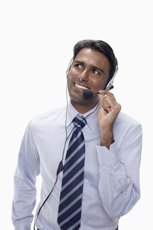 Businessman wearing headset Stock Photo - 17954570