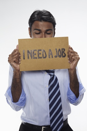Businessman holding  I need a job  sign Stock Photo - 17954642