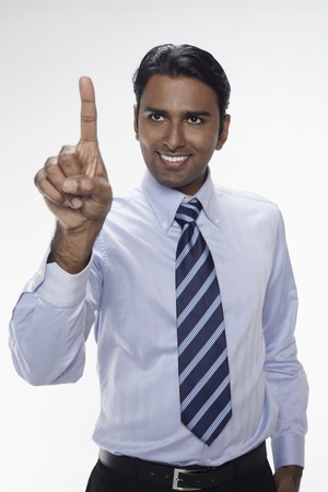 three people only: Businessman holding up index finger Stock Photo