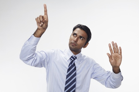 Businessman holding up his index finger and palm Stock Photo - 17954725