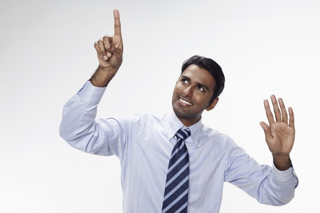 Businessman holding up his index finger and palm Stock Photo - 17954708