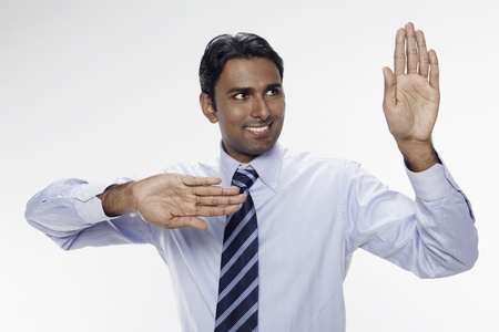 Businessman holding up his palms Stock Photo - 17954710