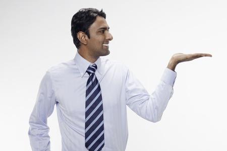 Businessman lifting up his palm photo