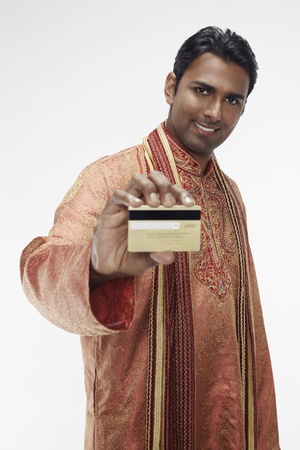 Man in traditional clothing holding credit card Stock Photo - 17954718
