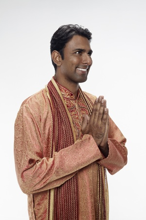 Man in traditional clothing showing greeting gesture Stock Photo - 17952513
