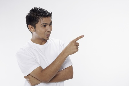 Man showing facial expression and pointing away Stock Photo - 17962968