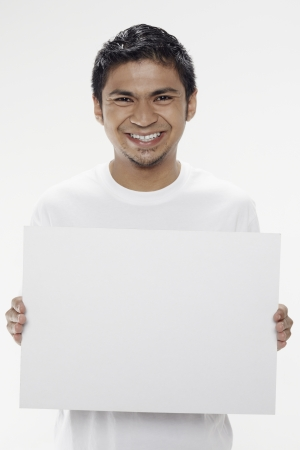 Man holding a blank placard Stock Photo - 17962886