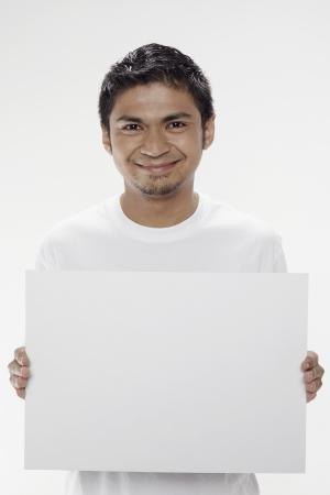 Man holding a blank placard Stock Photo - 17962895