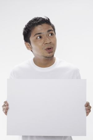 Man holding a blank placard Stock Photo - 17962885