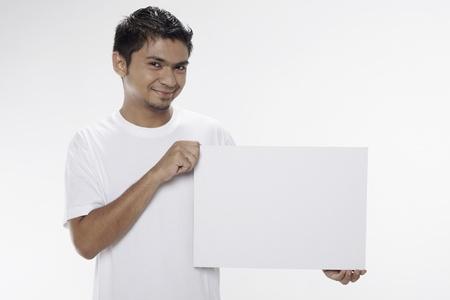 Man holding a blank placard Stock Photo - 17962901