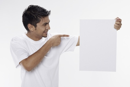 Man holding a blank placard Stock Photo - 17962893