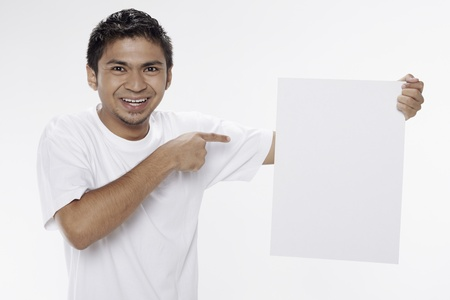 Man holding a blank placard Stock Photo - 17962888