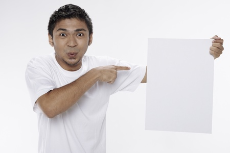 Man holding a blank placard Stock Photo - 17962889