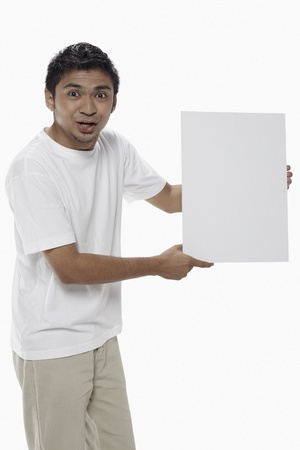 Man holding a blank placard Stock Photo - 17962890