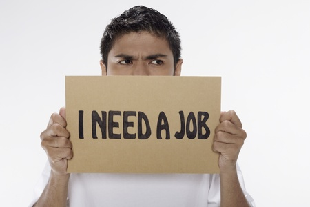 Man holding  I need a job  sign Stock Photo - 17962899