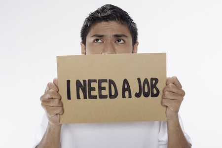 Man holding  I need a job  sign Stock Photo - 17962897