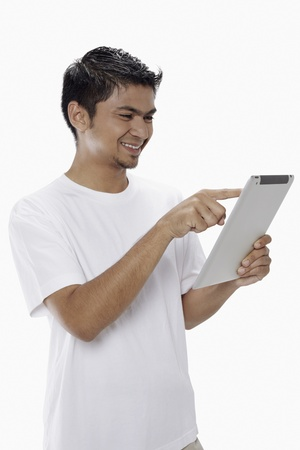 Man using digital tablet Stock Photo - 17962902