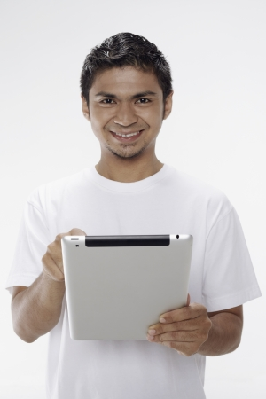 Man using digital tablet Stock Photo - 17962892