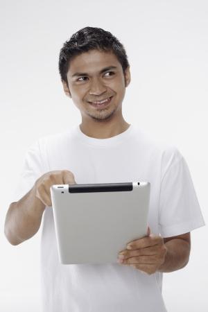 Man using digital tablet Stock Photo - 17962744