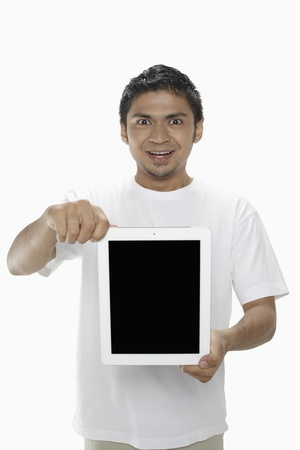 Man showing digital tablet Stock Photo - 17962732
