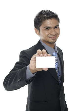 Businessman holding up his business card Stock Photo - 17962743