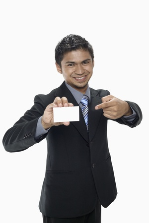 Businessman holding up his business card Stock Photo - 17962737