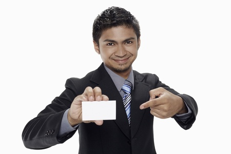 Businessman holding up his business card Stock Photo - 17962736