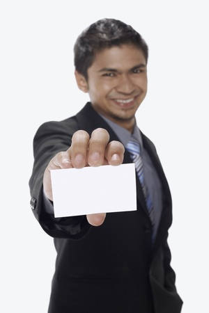 Businessman holding up his business card Stock Photo - 17962760
