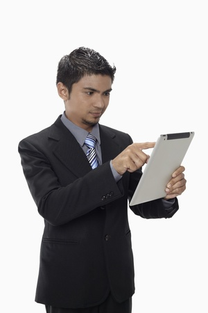 Businessman using digital tablet Stock Photo - 17962733