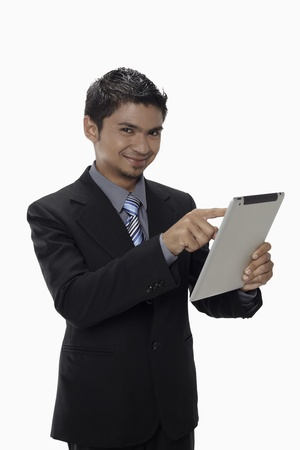 Businessman using digital tablet Stock Photo - 17962774