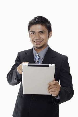 Businessman using digital tablet Stock Photo - 17962738