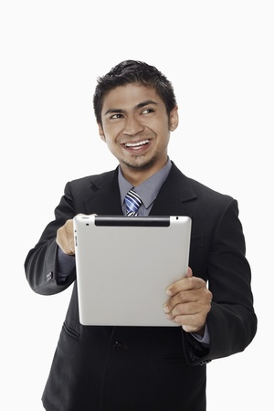 Businessman using digital tablet Stock Photo - 17962739