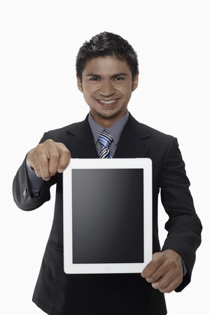Businessman showing digital tablet Stock Photo - 17962731