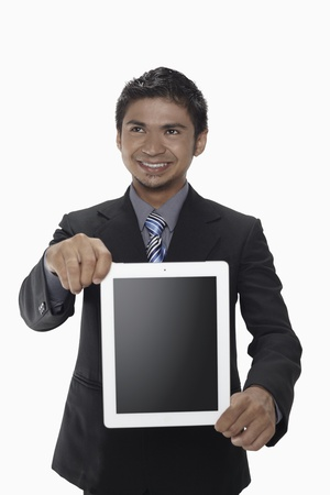 Businessman showing digital tablet Stock Photo - 17962748