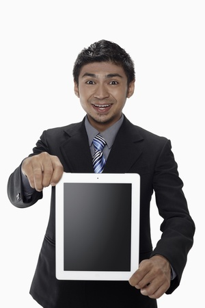 Businessman showing digital tablet Stock Photo - 17962735