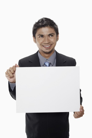 Businessman holding a blank placard Stock Photo - 17962538