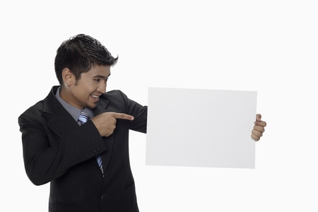 Businessman holding a blank placard Stock Photo - 17962537