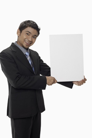 Businessman holding a blank placard Stock Photo - 17962529