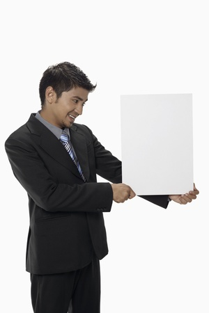 Businessman holding a blank placard Stock Photo - 17962530