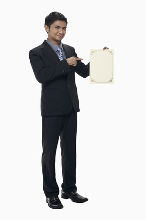 Businessman holding a blank certificate Stock Photo - 17962531