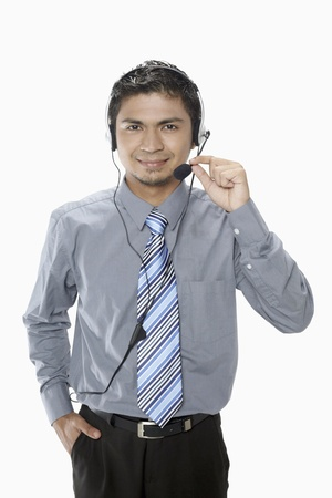 Businessman wearing headset Stock Photo - 17962391