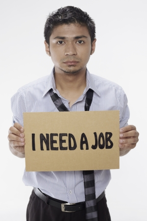 Businessman holding  I need a job  sign Stock Photo - 17961938