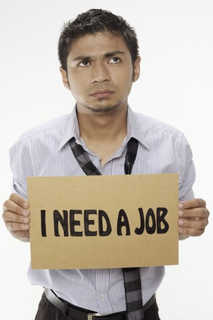 demotivated: Businessman holding  I need a job  sign