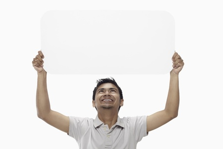 above 25: Man holding up a blank placard